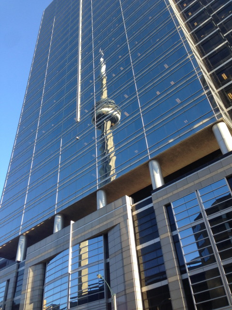 Reflexion of CN tower on one of the many glass skyscrapers in downtown Toronto